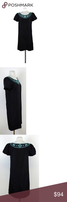 """Tory Burch- Black & Teal Embroidered Neck Silk Dress Sz 2 This stylish silky shift dress has teal embroidery and cutouts on the neckline. Made of silk, this dress can take you from day to evening with ease. Size 2 Body 100% silk Lining 100% polyester Concealed back zip w/clasp Round neckline Gathered bubble hem short sleeves Darts at bust Teal embroidery at neckline Cutouts at neckline Shift fit Shoulder to hem 35"""" Bohemian, preppy, hippy, young, & luxe are all words to describethis…"""