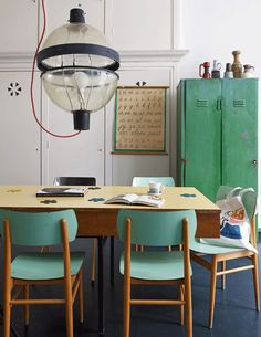 #green #dining room #industrial style / love those vintage chairs honey wood + green / for more inspiration visit http://pinterest.com/franpestel/boards/