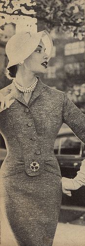 1955....I could rock this, unbutton top button, lose the hat....modern jewelry and a pop of color.  Great Dress!