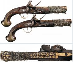 Elaborate Pair of Turkish Flintlock Holster Pistols with Gold Inlaid Accents and Wire Inlaid Stock, circa 1800.