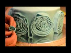 How to decorate a cake with fondant rosets or ribbon roses,rosette cake tutorial