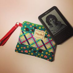 Kindle tech case with wrist strap. Prices range from $20-$60!