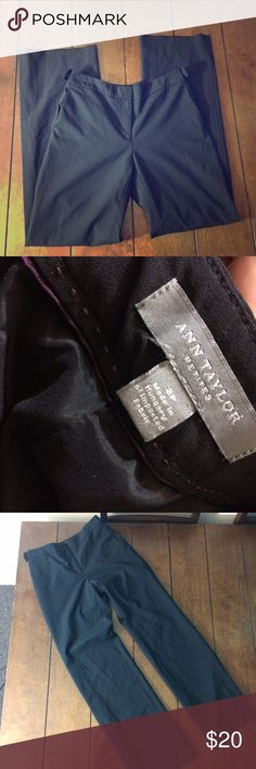 Black ann Taylor dress slacks Woman's size 2p black Ann Taylor dress pants. Button accents at waist, lined, front pockets. Waist measures 14 inches flat across, inseam is 31 inches and rise is 9 inches. Zipper and double clasp closure. Ann Taylor Pants Trousers