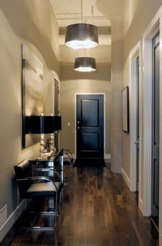 Black doors???  I ike this hallway and it matches the paint I love to use on all my walls, Gobi desert! :)