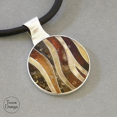Elegant silver pendant with Baltic amber. Handmade from scratch. Colorful, delicate and beautifully composed. The length of the strap: 64