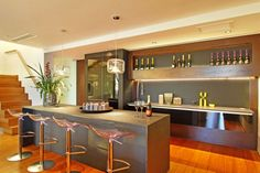 Architecture : Interesting open kitchen bar design ideas with table island and barstool and unique hanging pendant lamps picture - a part of Charming Villa Incorporating Boulders In Its Design