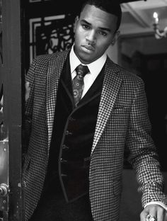 Chris Brown in a houndstooth jacket & velvet vest. Very tight. - H*