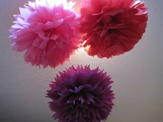 "Tissue paper pom poms over the dining table say ""party""! Yes, I made them."