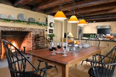 a remodeled farmhouse kitchen dining area view