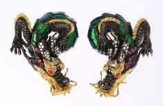 Adoring the beauty of nature, Lotus Arts de Vivre turns the natural into these unique earrings dragon design by covering  the body with scarab wings. The heads are made of sterling silver enhanced with white diamonds, pink tourmalines and red stone beads for eyes mounted in black rhodium sterling silver and 18K gold.  All done by hand and it took 8-10 people 2 months to finish these pair.