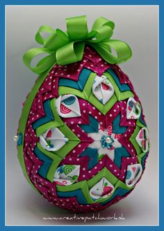 Quilted ornament with a little different touch. Quilted Fabric Ornaments, Quilted Christmas Ornaments, Beaded Ornaments, Ball Ornaments, Easter Crafts, Holiday Crafts, Easter Fabric, Homemade Ornaments, Easter Projects