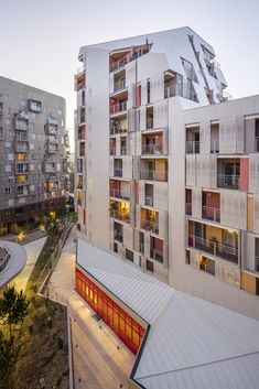 Mixed use centre by jean bocabeille architecte, paris, france. facade of metal panels and perforated, sliding shutters. Architecture Cool, Religious Architecture, Minimalist Architecture, Contemporary Architecture, Mixed Use, Social Housing, Facade Design, Modern Buildings, Color Of Life