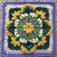 "A versatile, delicate looking decorative afghan square inspired by the lovely fresh perky greens and white of Snowdrop flowers.Perfect for repeats in a blanket or cushion cover. The finished square measures 8"" x 8"" or approximately 19cm square. Gauge is not too important but if you do tend to crochet quite tightly then a hook size up will help. :-)"