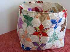 Quilted basket made from an old quilt scrap.