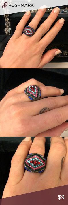 Multi-colored Jeweled Statement Ring Fun, colorful, and sparkly! Multi colors matched most of my outfits. Great accessory for a night out! Has stretchy backing so fits most ring sizes (5.5-9) Jewelry Rings