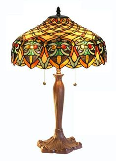 Make any living room look like a million dollars by adding an elegant Arielle stained-glass table lamp. This gorgeous hand-crafted Tiffany-style lamp gives you the bang of the classic Tiffany design motif without the hit to your wallet.