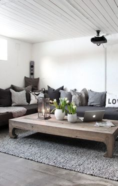 DIY chaise sofa. This would work well for my spa room. Twin size mattresses with simple frames and furniture legs. Just add extra large pillows and lots of them. I love this whole style for upstairs loft idea!