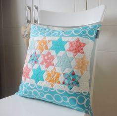 "Orange and aqua cushion, starts pillow, cushion 17"" X 17"""