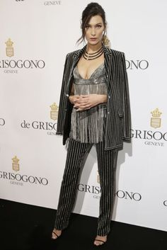 One of the most glamorous red carpets of the year, Cannes Film Festival, is officially here. Bella Hadid arrives in a striped metallic suit. See all the best red carpet fashion from Cannes here: