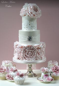 wedding-cakes-30-05092014nz   ~   Three tier pewter cake w piped lace and embellished w ruffled lavender peonies.