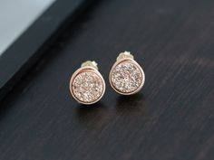 Perfectly petite 8mm round Druzy Quartz in a gilded rose gold titanium coating are wrapped in 14k rose gold filled wire in my signature bezel