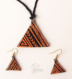 http://www.afday.com/collections/jewellery-1/products/orange-triangle-terracotta-set  Rs 485