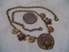 NOT signed but I am reasonably sure this necklace was made in the late 1930s, early '40s.Please re-read title and enlarge pictures for further details  This is a a stunning piece. I believe the metal is basically brass, but was it once plated?