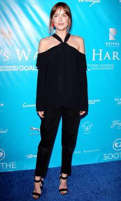 Dakota Johnson   all black outfit with red tassel earrings