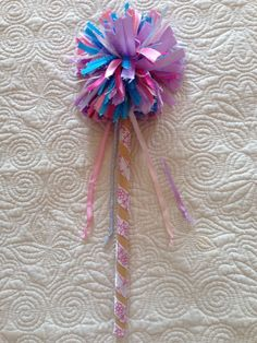 """Abby Cadabby Wand made with ribbon.   Wind a variety of ribbon around a 4"""" piece of cardboard. Slide it off the cardboard and secure it in the center with a covered rubber band. Snip the ribbon loops on both sides to make a pompon. Put hot glue on the end of a wooden dowel and insert it into the center of the pompon. Hold securely until glue dries. Sesame Street Costumes, Sesame Street Party, Sesame Street Birthday, Abby Cadabby Costume, Diy Baby Costumes, 80th Birthday, 2nd Birthday Parties, Diy Wand, Halloween 2017"""