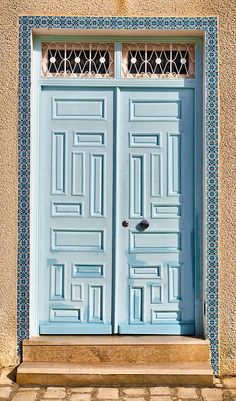 Blue door by Siuloon, via Flickr
