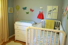 Grey and yellow nursery with a lot of DIY projects and girly details.