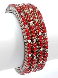 Exclusive and very Latest set of 4 Pcs Indian Designer Lakh Bangles, crafted and designed beautifully with high quality glass stones.