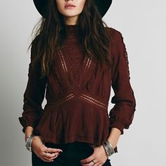 Free People New Romantics Rosemary Blouse NWOT size Small. There is too much to say about this blouse. A Victorian style top with tons of features including A high neck featuring mesh & lace, ruffles throughout top, buttons on shoulder. Absolutely stunning and in excellent condition. The color is brown. Free People ✨ New Romantics line. Free People Tops