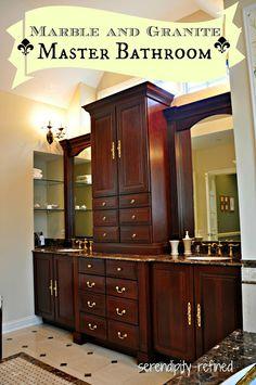 Serendipity Refined Dark Wood Master Bathroom Cabinets, Sconces, Mirrors Tile, Glass Shelves, Crema Marfil Marble, Emperador Dark Granite, shower, tile rug, mosaic, tub surround