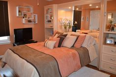 Before this room was almost completely beige. Now it is a warm, cozy escape into sleep. The color-blocked bedspread translates into the color of the wall, the furniture, and the dark bamboo flooring. Accents of white help to keep the room clean looking and bright!