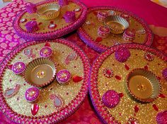 Round mehndi plates in luscious pink and gold. See my face book page Www.facebook.com/mehnditraysforfun