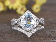 aquamarine ring set white gold halo diamond ring bridal ring set Deco split shank band pear cut natural aquamarine ring Source by Wedding Rings Teardrop, Diamond Wedding Rings, Halo Diamond, Bridal Ring Sets, Bridal Rings, Aquamarin Ring, Vintage Engagement Rings, White Gold Rings, Or