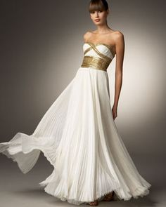 A simple dress with gold belt. Simply stunning!