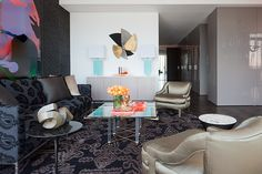 A Docklands penthouse in Melbourne by interior designer David Hicks. Pattern and colour is juxtaposed to play on the Dale Frank painting. Paisley and ikat patterns contradict but sit easily together while vintage aqua lamps and fluoro orange bowl by Alexandra Von Furstenberg add another dimension to the painting. Image - Shannon McGrath. David Hicks is profiled on the Temple & Webster blog as part of David Clark's Edit. http://blog.templeandwebster.com.au/david-clarks-edit-david-hicks/