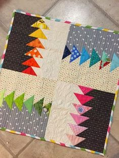 Dizzy Quilts: TGIFF - A Mini Finish I know these are flying geese blocks, but they can easily be made with HST blocks instead.