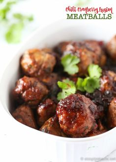 Chili Cranberry Fusion Meatballs - This easy slow cooker recipe is full of sweet heat! Made with ground chicken, Asian flavours plus cranberries! Yum. | simplystacie.net