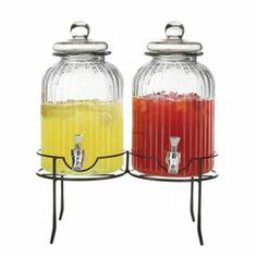 """2 fluted glass beverage dispensers on a metal stand.  Product: 2 Beverage dispensers and 1 standConstruction Material: Metal and glassColor: Clear, black and silverFeatures: 1.38 Gallon capacity eachDimensions:  14"""" H x 17"""" W x 8"""" D (overall)Cleaning and Care: Hand wash recommended"""