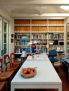 Fancy Ideas For A Multipurpose Office Space With White Wall Glass Window Big Storage White Long Table Wooden Desk Wooden Floor
