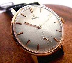Gorgeous 1950's 18k Rose Gold Omega manual wind dress watch with sub seconds. See more at finesthourvintage.com