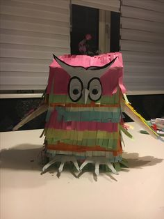 owl with paper and feathers