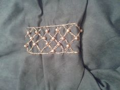 Upper arm medieval embroidery
