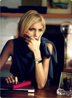 Fashion: New York City Style. Navy blue satin blouse, bracelet, watch, manicure, natural makeup. Anja Rubik for Harper's Bazaar February 2009. Photographer: Peter Lindbergh.