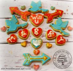 Marry Me Cookies Marry Me Cookies The brief was birds, arrows, and red. Got it! We simply adore this cookie set. Who could say no to such a sweet proposal... #featured-cakes #cookies #royal-icing #nfsc #decocookies #cakecentral