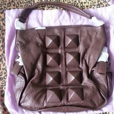 Deux lux handbag Brown Bag with brown studs in the front. Dust bag included.  Brand new never used. Deux Lux Bags