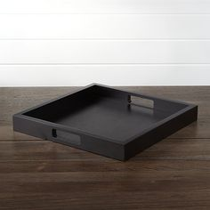 Wood serving tray in chic black squares away drinks and snacks. Each wooden tray is crafted with cabinetry precision, with cutout handholds for utility with style.